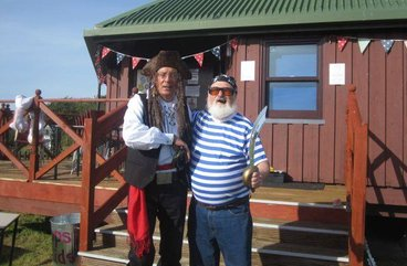 Volunteers dressed as pirates outside The Sand Bothy